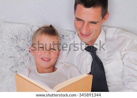 Businessman father reading book with child. Father and son. Education, happy family concept - stock photo