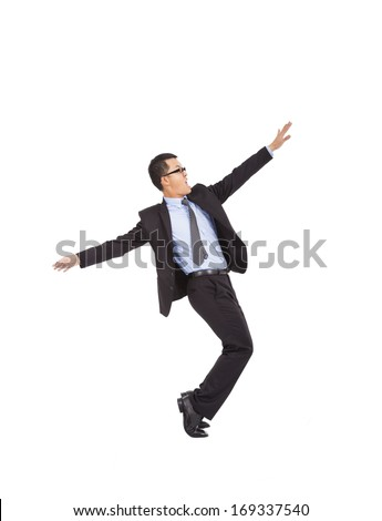 businessman feel happy to raise his hands and  dancing   - stock photo