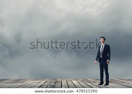 Businessman feel surprised look sky.