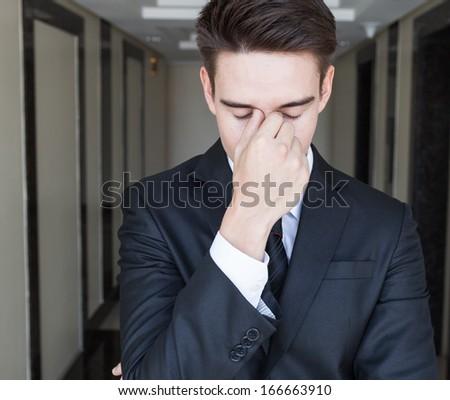 Businessman feeling stressed - stock photo