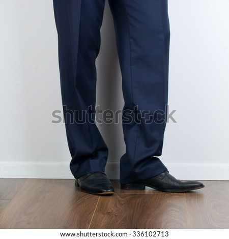 Businessman feet in black boots on the floor