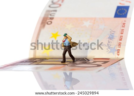 businessman figurine running on a euro banknote,isolated on white with clipping path - stock photo