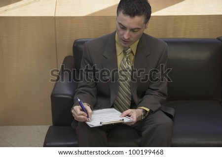 Businessman filling out a form