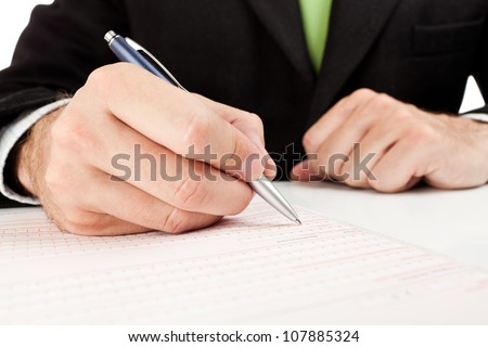 Businessman fills out a form. - stock photo