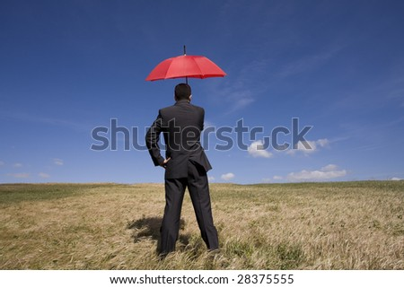 Businessman finding protection outside in the field