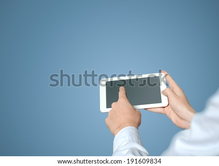 Businessman finger working with tablet mobile computer screen - stock photo