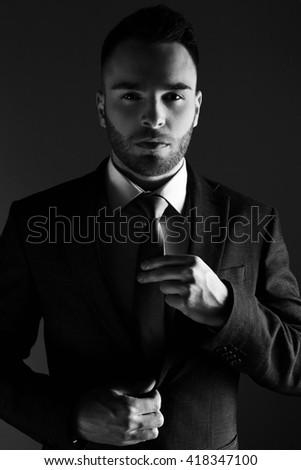 Businessman Fixing his Suit  - stock photo