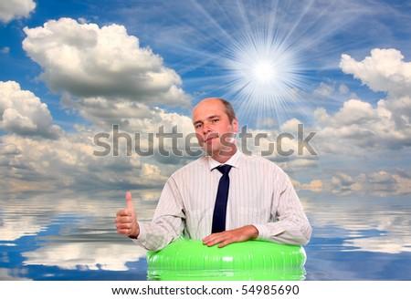 Businessman floating on life ring. Insurance metaphor. - stock photo