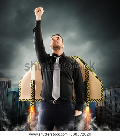 Businessman flying with cardboard wings with turbines - stock photo