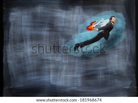 Businessman flying with rocket backpack - stock photo
