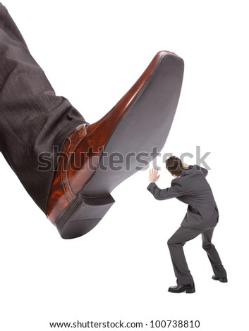 Businessman foot about to stamp out the competition concept for business problems, bullying or hostile take over - stock photo