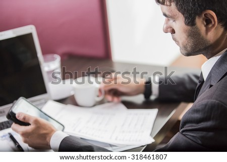 businessman freelancer working at a laptop
