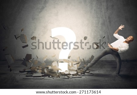 Businessman frightened by a big question point - stock photo