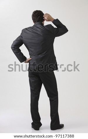 Businessman from behind,with doubt - stock photo