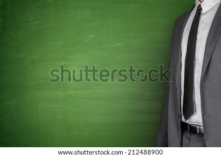 Businessman front of Blackboard - stock photo