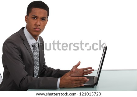 Businessman frustrated by laptop - stock photo
