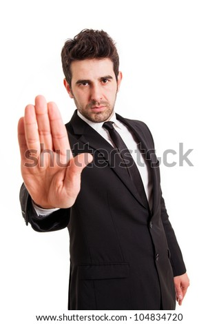 Businessman gestures STOP with his hand, isolated on white - stock photo