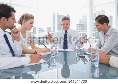 Businessman gesturing during a meeting as he looks angry - stock photo