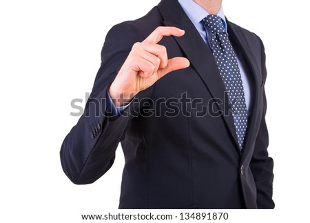 Businessman gesturing small size with fingers. - stock photo