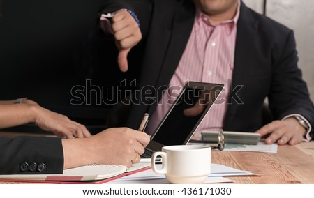 Businessman gesturing thumbs down  - stock photo