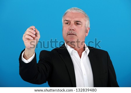 Businessman gesturing with pen