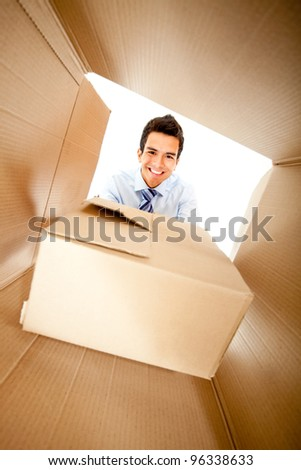 Businessman getting a special delivery and smiling