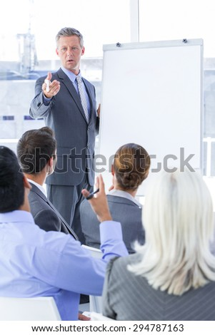 Businessman give a presentation in a meetingroom