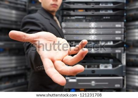 Businessman give the hand for help in data center room