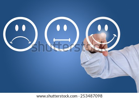 Businessman gives a positive vote for service quality with a smiley - stock photo