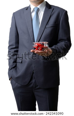 Businessman gives the model airplane to the customer isolated on white background, airline business concept - stock photo