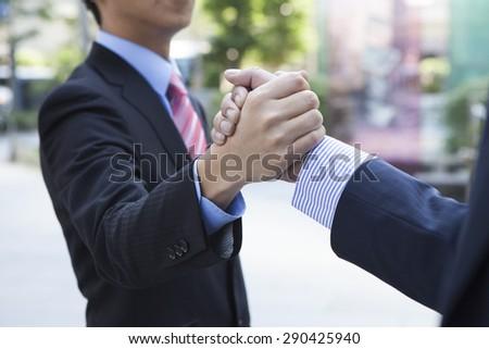 Businessman giving a handshake - stock photo