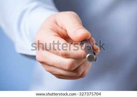 Businessman  giving a pen to you, blue background