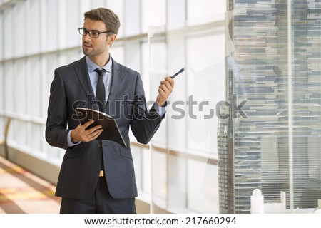Businessman giving a speech in a conference/meeting room - stock photo