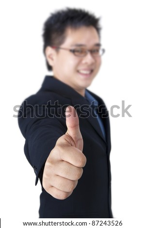 Businessman giving an enthusiastic thumb up - stock photo