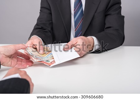Businessman giving cash money to a person