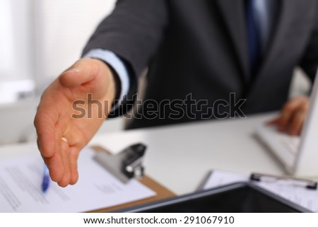 Businessman giving hand for shaking hands - stock photo
