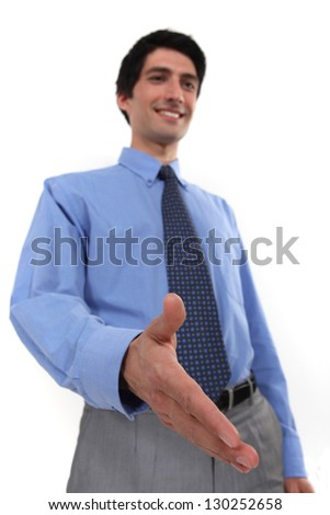 businessman giving his hand for a handshake - stock photo