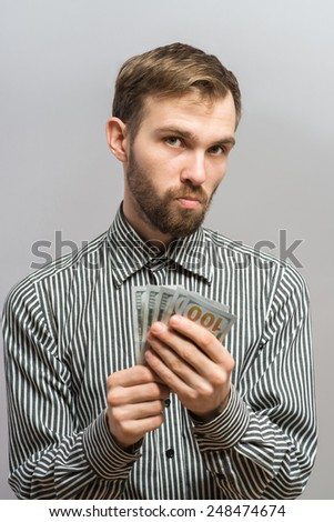 Businessman giving money  - stock photo