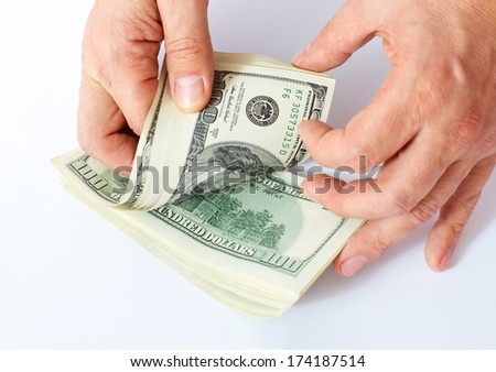 Businessman Giving Money Cash Dollars in  Hands of passing them to the client. Concept of Time is Money. Isolated, Space for Text - stock photo