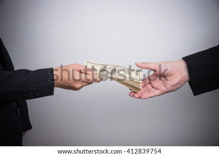 Businessman giving money on white background