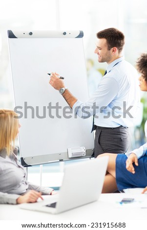 Businessman giving presentation at meeting  - stock photo