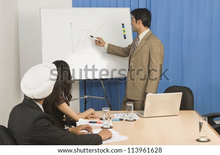 Businessman giving presentation in a conference room - stock photo