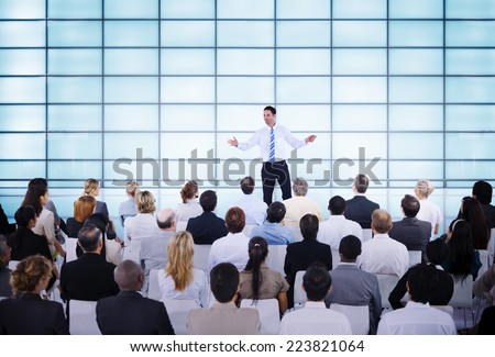 Businessman giving presentation to his Colleagues - stock photo