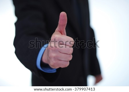 Businessman giving thumbs up sign