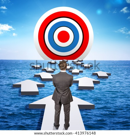 Businessman goes through obstacles to goal. Man in suit standing on arrow. Ahead of target - stock photo