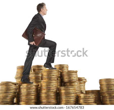 Businessman goes up the gold coins on a white background