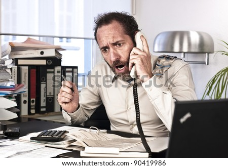 Businessman goes upset while on the phone {shot on PhaseOne P45} - stock photo