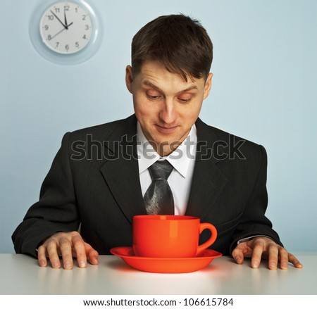 Businessman going to drink a very strong and very hot coffee - stock photo