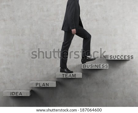 Businessman going up. - stock photo