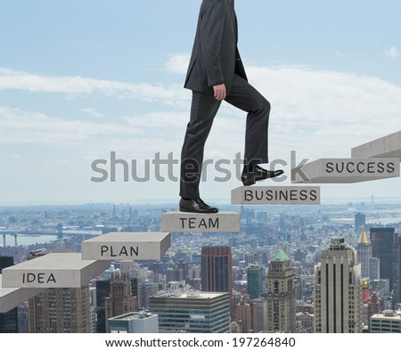 Businessman going up - stock photo